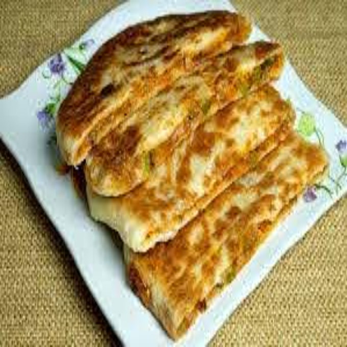 /Content/Products/ProductImages/10357/Pizza--Paratha1.jpg